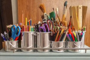 Art supplies in silver cannisters